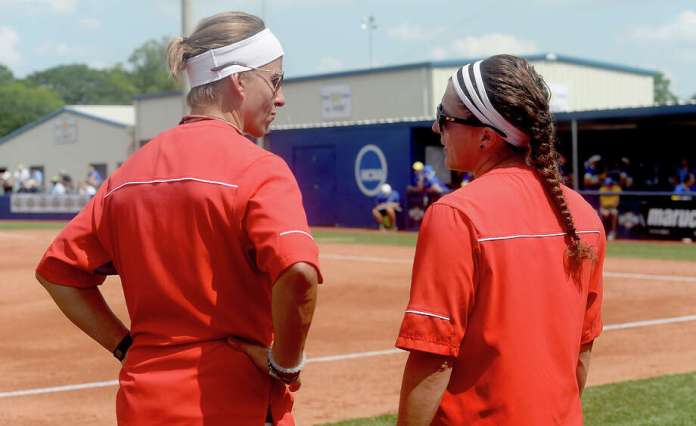 Lamar's head coach Holly Bruder and assistant Allison Honkofsky talk on the baseline as they face McNeese State in the championship round of the Southland Conference tournament Friday. The Lady Cardinals took runner-up after falling to the Cowgirls 5-2. Photo taken Friday, May 13, 2016 Kim Brent/The Enterprise Photo: Kim Brent / Beaumont Enterprise