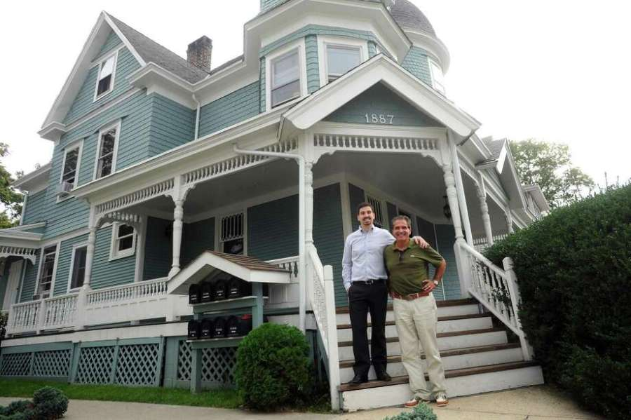 Queen Anne style home a throwback to Stamford s earlier days     Maurice Nizzardo  center right  and son Cody Nizzardo pose in front of the  blue