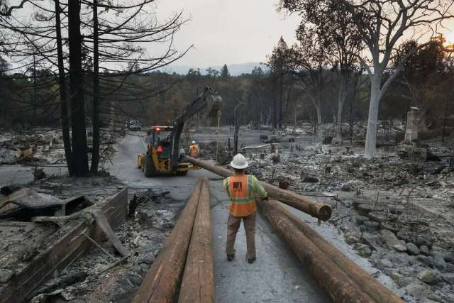 Following a year of devastating California fires, the CPUC just approved new rules that will require utilities to have more clearance between power lines and vegetation. Photo: Paul Kuroda, Special To The Chronicle