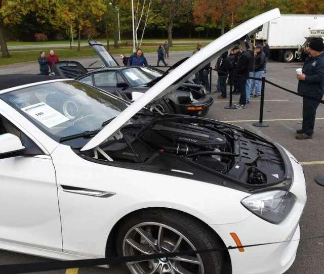 A  Convertible  Turbo And A Lamborghini Gallardo Are Viewed