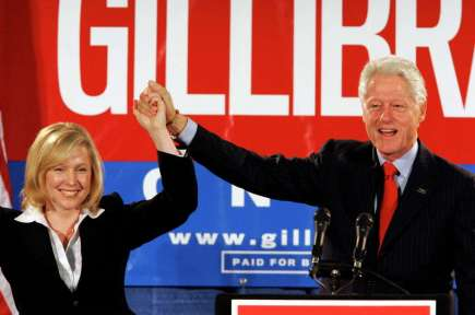 Former President Bill Clinton holds up the hand of Kirsten Gillibrand, a Democratic lawyer who is running against three-term Rep. John Sweeney, R-N.Y., at a rally in Albany, N.Y. on Oct. 26, 2006. Sen.