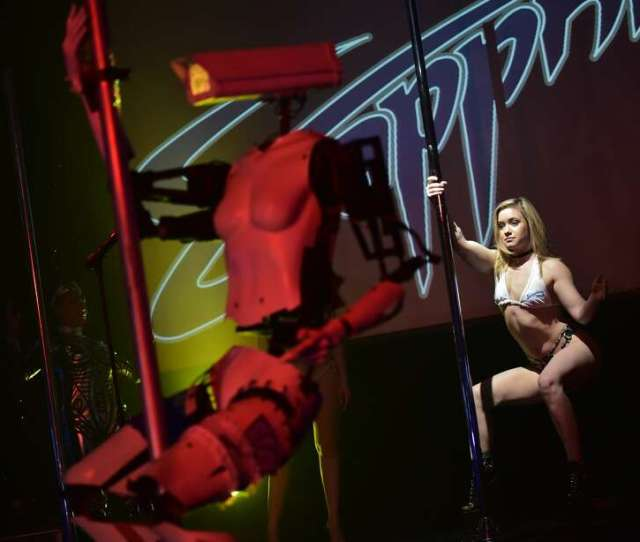 A Human Dancer Performs Next To A Stripper Robot At The Sapphire Gentlemens Club On The