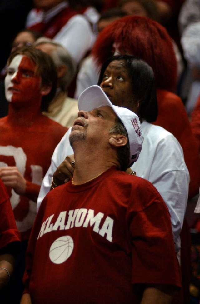 Oklahoma fans look to the scoreboard, but didn't have much to cheer about during Syracuse's 63-47 victory over Oklahoma on March 30, 2003.