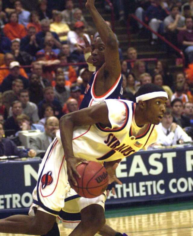 Syracuse's Hakim Warrick reaches for a rebound against Auburn on March 28, 2003.