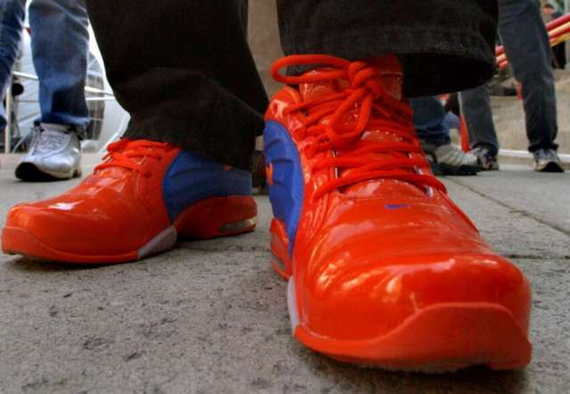 Tom Killips of Clifton Park, a Syracuse alum, sports his custom-made shoes in support of his team during the NCAA Basketball Fan Fest on Friday, March 28, 2003, outside the Pepsi Arena in Albany.