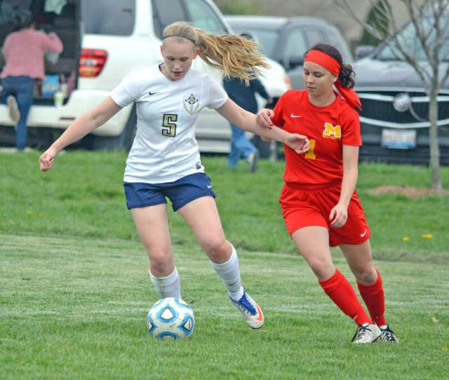 Father Mcgivney Freshman Rachel Maller Left Controls The Ball During The First Half Of
