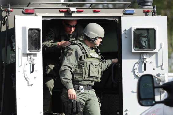 Emergency responders respond to an active shooter in front of Santa Fe High School Friday, May 18, 2018, in Santa Fe. Photo: Steve Gonzales, Houston Chronicle / © 2018 Houston Chronicle