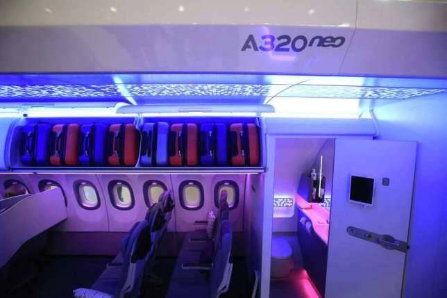 A restroom door stands open inside a new Airbus A320neo cabin at the Aircraft Interiors Expo in Hamburg, Germany, on April 11, 2018. Photo: Bloomberg Photo By Krisztian Bocsi. / © 2018 Bloomberg Finance LP