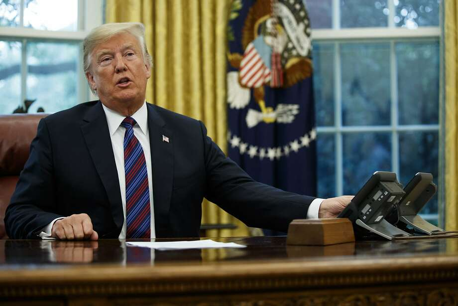 President Donald Trump talks on the phone with Mexican President Enrique Pena Nieto, in the Oval Office of the White House, Monday, Aug. 27, 2018, in Washington. (AP Photo/Evan Vucci) Photo: Evan Vucci / Associated Press