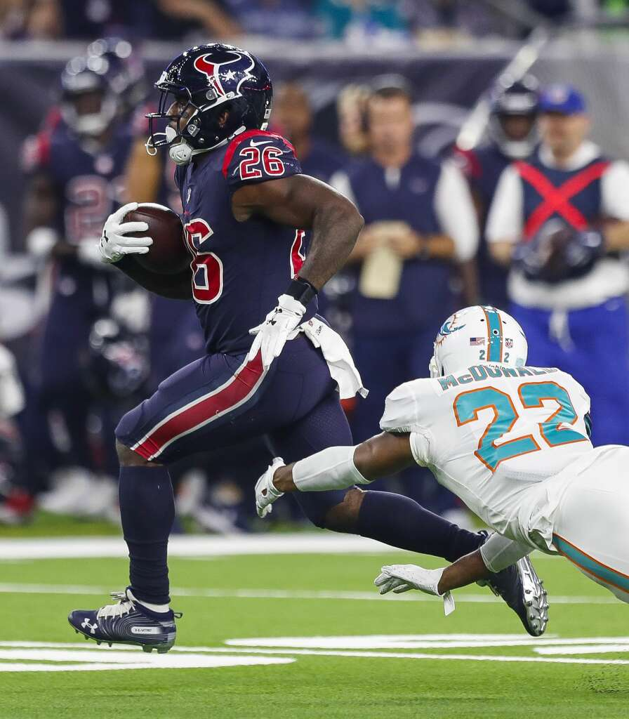Houston Texans running back Lamar Miller (26) evades Miami Dolphins strong safety T.J. McDonald (22) during a long run during the third quarter of an NFL football game at NRG Stadium on Thursday, Oct. 25, 2018, in Houston. Photo: Brett Coomer/Staff Photographer
