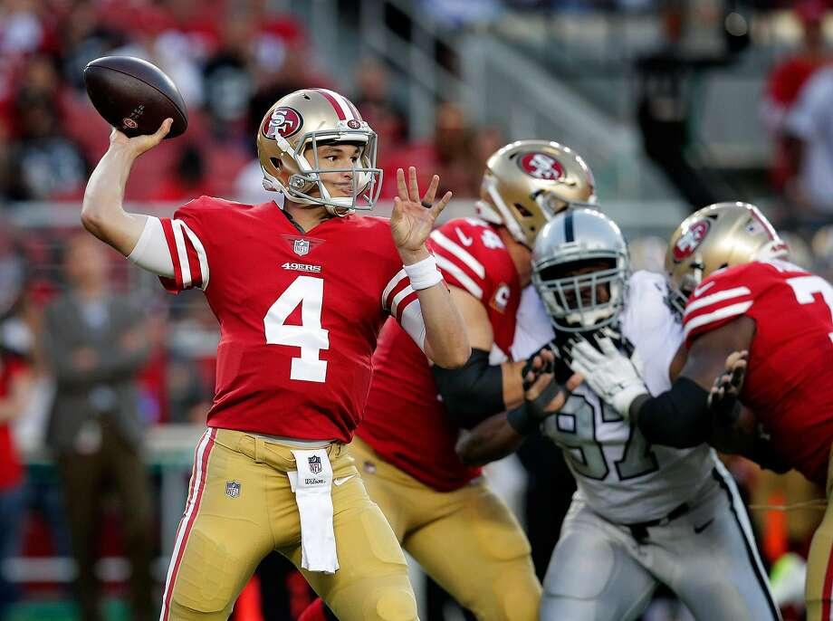 San Francisco quarterback Nick Mullens (4) throws in the first quarter as the San Francisco 49ers play the Oakland Raiders at Levi's Stadium in Santa Clara, California on Thursday, November 1, 2018. Photo: Carlos Avila Gonzalez / The Chronicle