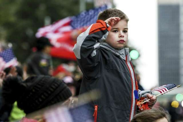 Matthew Marcoux, 10, salutes as he watches the parade at the Houston Salutes American Heroes Veterans Day Celebration Sunday, Nov. 11, 2018, in Houston honoring the 100th Anniversary of the signing of the World War I Armistice. Photo: Michael Ciaglo, Houston Chronicle / Staff Photographer / Michael Ciaglo