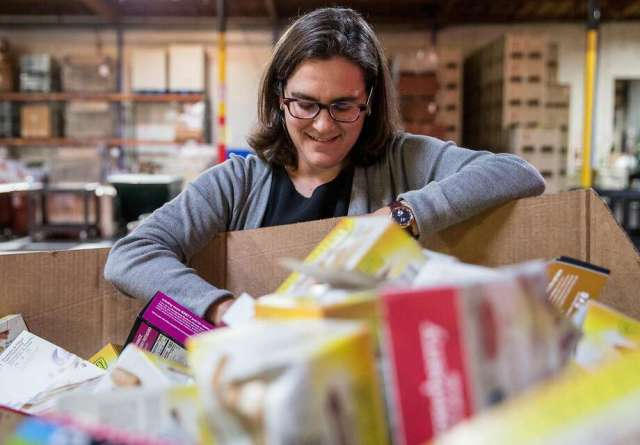 Dr. Hilary Seligman, director of UCSF's Food Policy, Health and Hunger Research Program, sorts through items at the Alameda County Community Food Bank in Oakland. Photo: Jessica Christian / The Chronicle