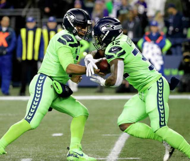 Seattle Seahawks Quarterback Russell Wilson Left Hands Off To Chris Carson Against The Minnesota