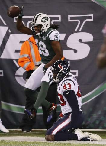 <p>New York Jets wide receiver Andre Roberts (19) celebrates his 13-yard touchdown reception over Houston Texans defensive back Shareece Wright (43) during the third quarter of an NFL football game at MetLife</p>