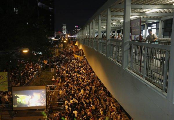 Hong Kong Students Storm Government HQ to Demand Full ...