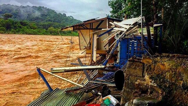 Rio Baru overflows and destroys a home in Dominical, Puntarenas Province, Costa Rica, during TS Nate on 10/5/2017