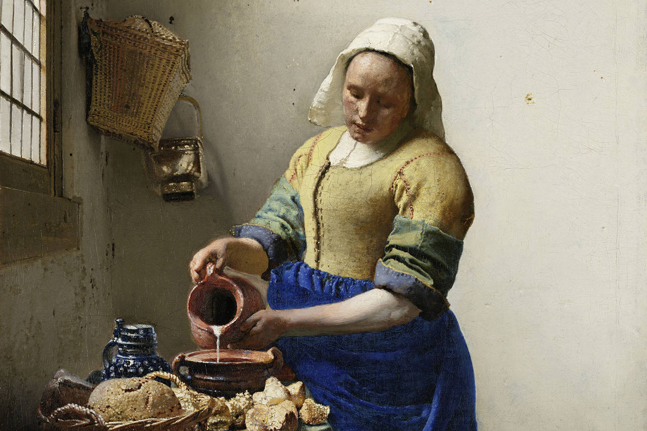 Woman pouring milk from a jug
