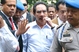 [Indonesia's anticorruption chief Antasari Azhar, center, was detained in a murder probe Monday. His lawyer said he had 'no link' to the killing.]