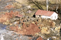 Awareness of potential coal-ash problems burst into the news at the end of 2008, when a dike broke at a pond near a power plant in Tennessee. Left, a home destroyed in the incident.