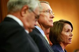 [Speaker of the House Nancy Pelosi (right) speaks during a news conference with House Financial Services Committee Chairman Barney Frank (left) and Senate Majority Leader Harry Reid.]