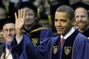 President Barack Obama acknowledges the applause of the crowd as he arrives for commencement ceremonies at the University of Notre Dame. ASSOCIATED PRESS