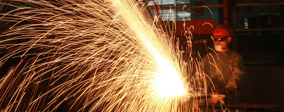 [A labourer works at a steel plant in Huaibei in eastern China's Anhui province.]