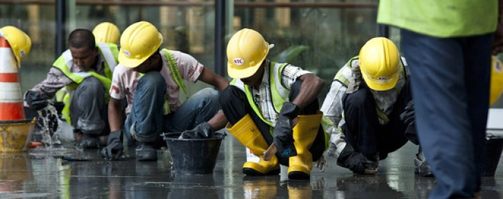 Foreign workers in Singapore tiling road