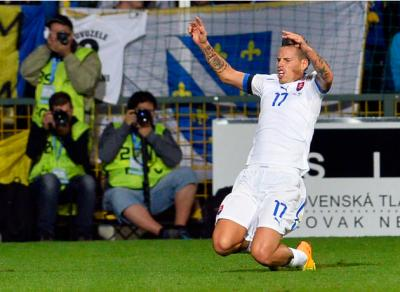 Slovakia's Marek Hamsik celebrates after scoring a goal against Bosnia during their 2014 World Cup qualifying soccer match in Zilina