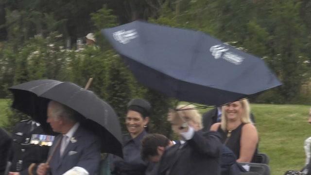 Boris Johnson struggles with his umbrella again leaving Prince Charles  laughing