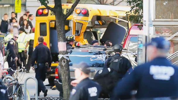 PHOTO: Authorities respond near a damaged school bus, Oct. 31, 2017, in New York. (Bebeto Matthews/AP)