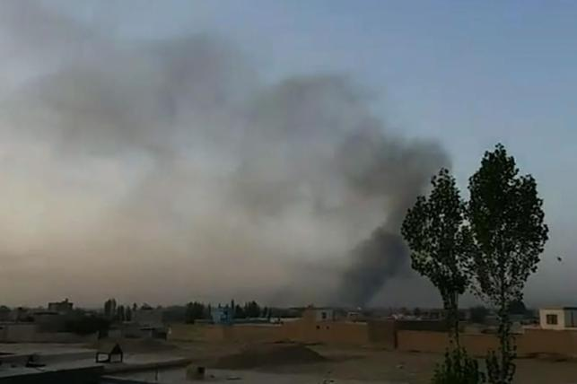 Screen grab from AFPTV video taken on August 10, 2018 shows smoke rising after Taliban militants launched an attack on the Afghan provincial capital of Ghazni