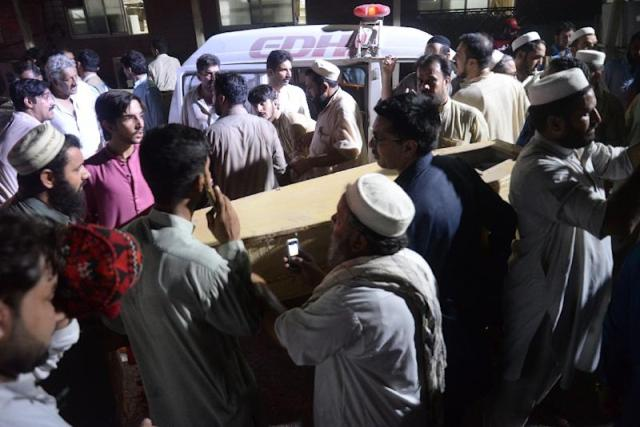 A suicide bomber killed at least 13 people at an election event in northwest Pakistan (AFP Photo/ABDUL MAJEED)