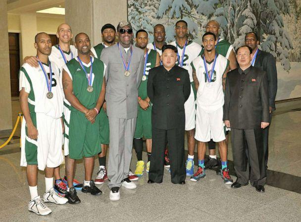 PHOTO: Former U.S. basketball star Dennis Rodman (3rd from L, front row) and other American basketball players pose for photos with North Korean leader Kim Jong Un (3rd from R, front row) at the Pyongyang Indoor Stadium, Jan. 8, 2014. (Kyodo News via Getty Images)