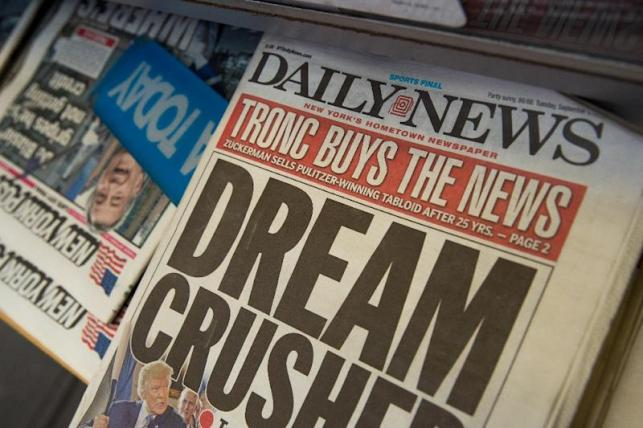 The New York Daily News, known for its bold front pages, is slashing half its editorial staff as it seeks to adapt to the financial troubles of the sector (AFP Photo/Drew Angerer)