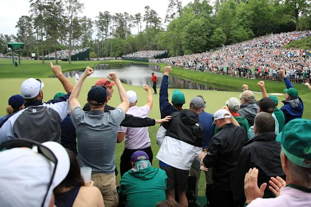 Patrons cheer as Tiger Woods of the United States celebrates his birdie on the 16th green during the final round of the Masters at Augusta National Golf Club on April 14, 2019 in Augusta, Georgia. (Getty Images)