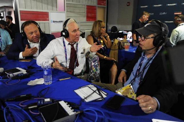 "Alex Jones (L), of Infowars, and Roger Stone, a former Donald Trump advisor, debate with Jonathan Alter during an episode of Alter Family Politics during the 2016 election campaign -- Facebook has removed several of Jones' online pages from its platform, accusing him of ""glorifying violence."""