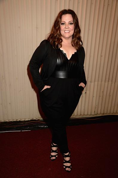 Melissa McCarthy in a head-to-toe black ensemble