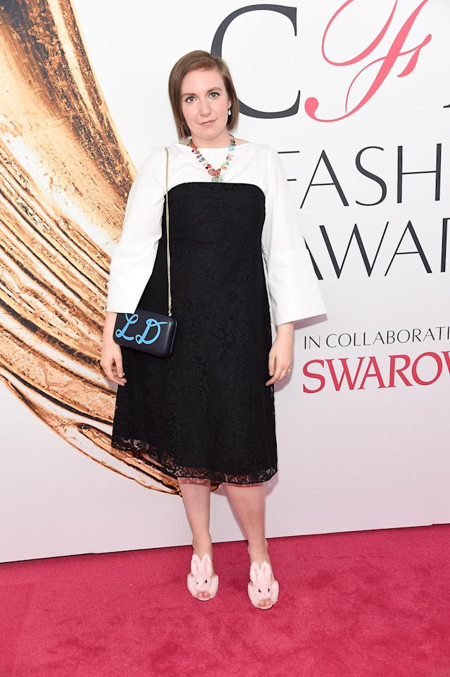 <p>Lena Dunham, who accompanied jewelry designer Irene Neuwirth to the award ceremony, accessorized her black and white look with fuzzy bunny heels Streetzies. Also, Irene Neuwirth jewelry. <i>(Photo: Getty Images)</i><br /></p>