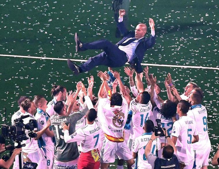MADRID, May 27, 2018 -- Real Madrid's head coach Zidane is thrown into the air by players during the celebration at Santiago Bernabeu Stadium in Madrid, Spain, on May 27, 2018. Real Madrid claimed the title of UEFA champions league in Kiev on Saturday. (Xinhua/Guo Qiuda via Getty Images)