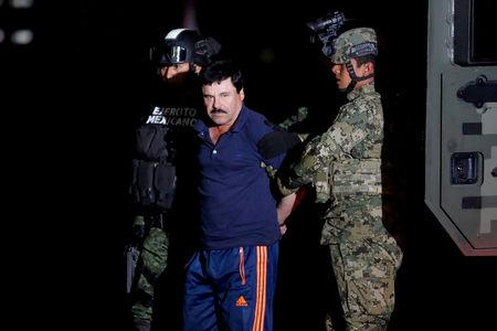 """FILE PHOTO: Joaquin """"El Chapo"""" Guzman is escorted by soldiers during a presentation in Mexico City"""