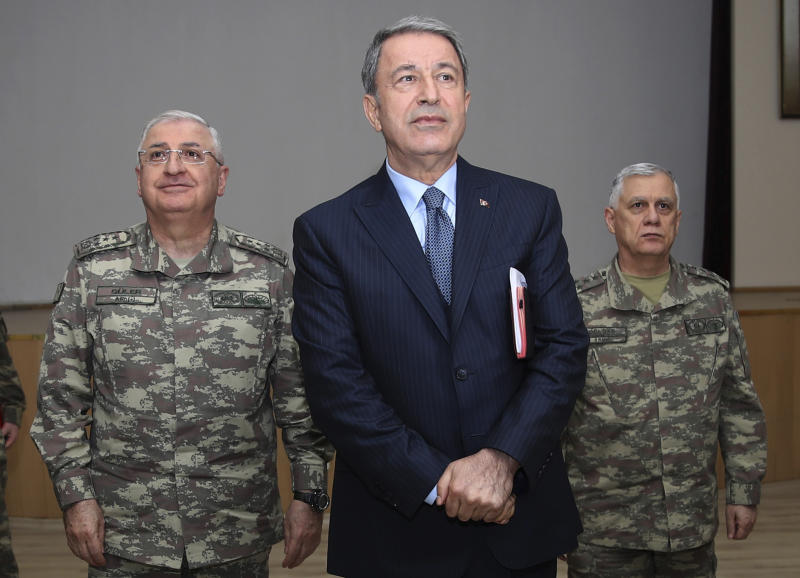 "Turkey's Defence Minister Hulusi Akar listens during a meeting with the commanders of military units on Syrian border in Sanliurfa, southeastern Turkey, Friday, Jan. 11, 2019. Akar on an unannounced visit to troops stationed near the Syrian border reiterated Ankara is ""determined"" to fight Kurdish militia it considers terrorists. Shipment of military equipment to the border continued Friday, he did not address the U.S. pullout. (Turkish Defence Ministry via AP)"