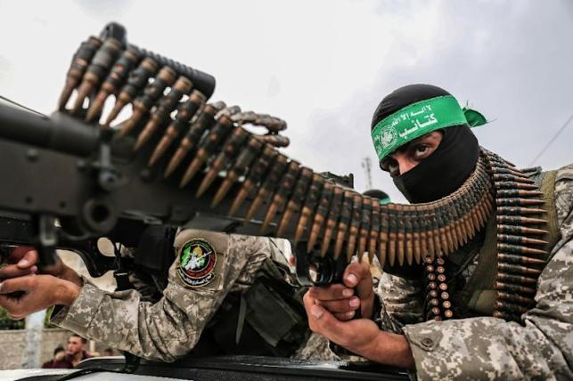 Fighters from the Ezzedine al-Qassam Brigades, the armed wing of the Palestinian Hamas movement, take part in a military show in the southern Gaza Strip city of Khan Yunis on December 5, 2017