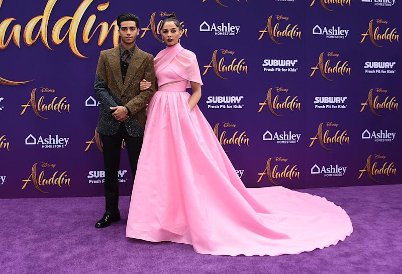 """Mena Massoud, left, and Naomi Scott arrive at the premiere of """"Aladdin"""" on Tuesday, May 21, 2019, at the El Capitan Theatre in Los Angeles. (Photo by Jordan Strauss/Invision/AP)"""