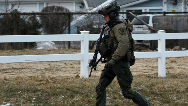 PHOTO: A law enforcement officer works at the scene of a shooting at the Henry Pratt Co. on Friday, Feb. 15, 2019, in Aurora, Ill. (AP)