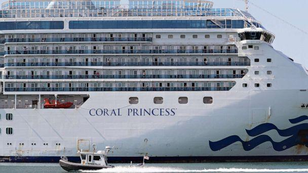 PHOTO: A Miami-Dade police boat passes in front of the cruise ship Coral Princess after its docking in Port Miami, on April 04, 2020, in Miami. (Joe Raedle / Getty Images)