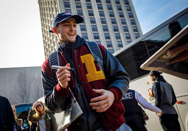 Loyola guard Clayton Custer signs autographs as fans welcome the Ramblers back to campus after the team advanced to the Sweet 16 of the NCAA tournament. (Getty)
