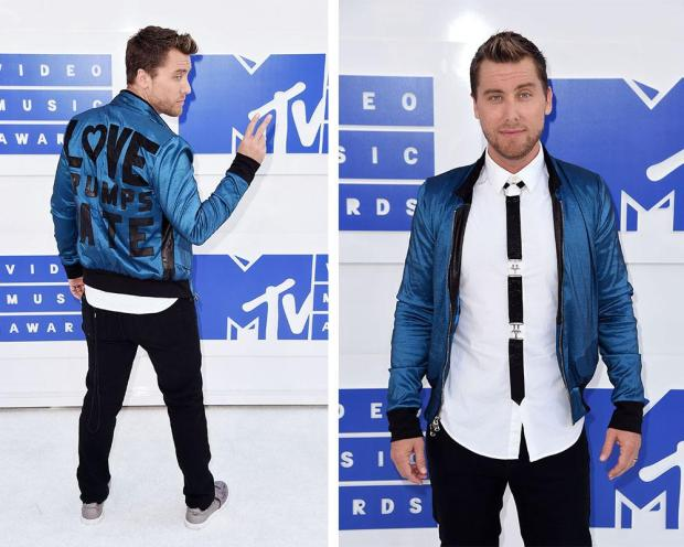 "<p>The former boy bander made a political statement in addition to a fashionable one by wearing a blue satin bomber with the word ""Love Trumps Hate"" on the back. He also had on a bondage-inspired tie. <i>(Photo: Getty Images)</i></p>"