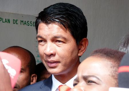 FILE PHOTO - Madagascar presidential candidate Andry Rajoelina leaves the polling centre after casting his ballot during the presidential election in Ambatobe, Antananarivo, Madagascar December 19, 2018. REUTERS/Clarel Faniry Rasoanaivo