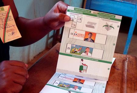 FILE PHOTO: An electoral official holds the ballot paper containing the electoral details of Madagascar presidential candidates Andry Rajoelina and Marc Ravalomanana at a polling centre in Antananarivo, Madagascar December 19, 2018. REUTERS/Clarel Faniry Rasoanaivo//File Photo